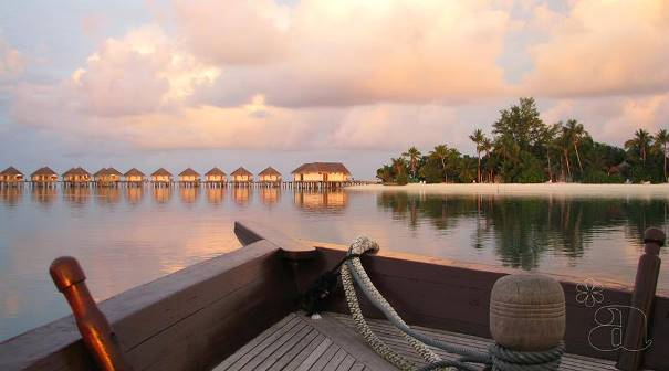 View from a Luxury Boat shows the island and Water Villas.