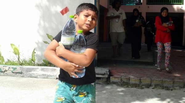 boy collects water